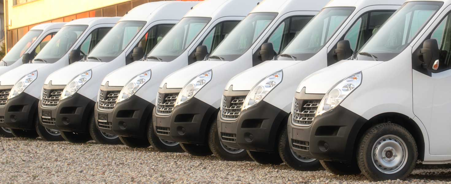 Commercial vehicle vans parked in a row.